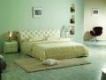 Двуспальная кровать 1031 с отделкой из натуральной кожи или из Эко Кожи
